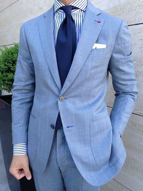 Blue stripe shirt with sky blue suit and navy neck tie