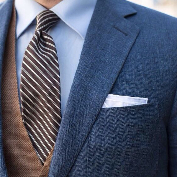 Mismatched brown blue three-piece suit